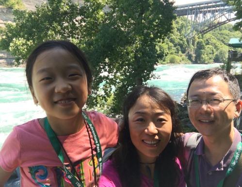 My daughter and husband with me at Niagara Falls, Canada.