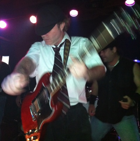 Doing my best impression of AC/DC guitarist Angus Young at a recent gig.
