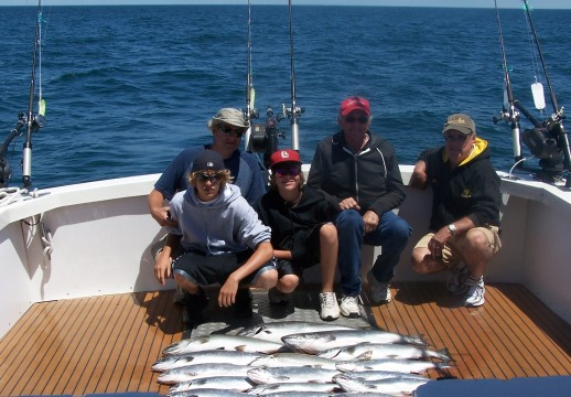 A fishing trip on Lake Michigan with my two sons and their grandfathers. The salmon were biting that day!